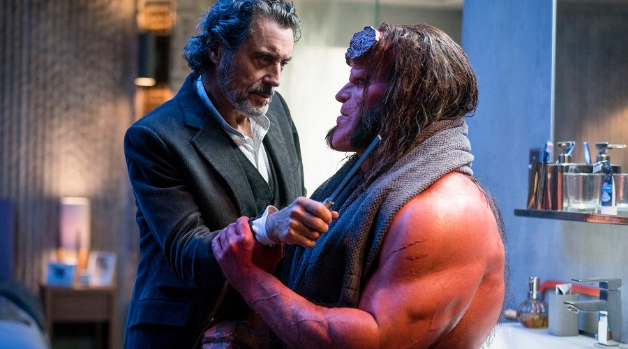 Hellboy eats pizza and learns about a giant problem in the reboot's first clip!